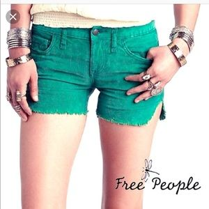 Free People green cord dolphin hem shorts size 28